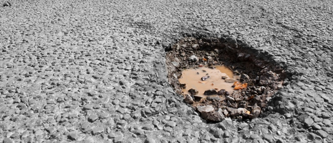 Featured Image for Don't Let Potholes and Winter Pavement Damage Hurt Your Business